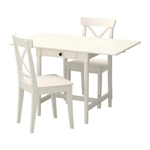 IKEA INGATORP/INGOLF table and 2 chairs The clear-lacquered surface is easy to wipe clean.
