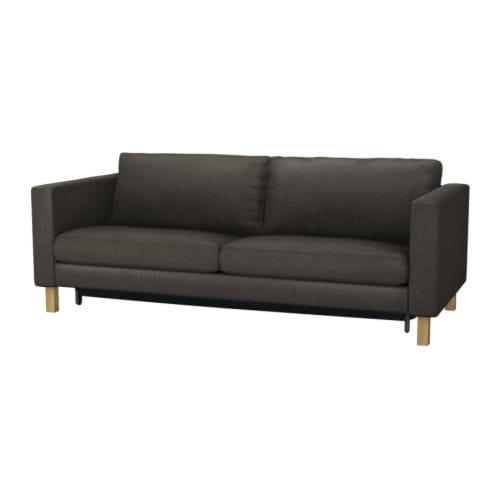 KARLSTAD Three-seat sofa-bed w storage IKEA Storage space under the seat for pillows and quilts for two.  Readily converts into a bed for one or two.