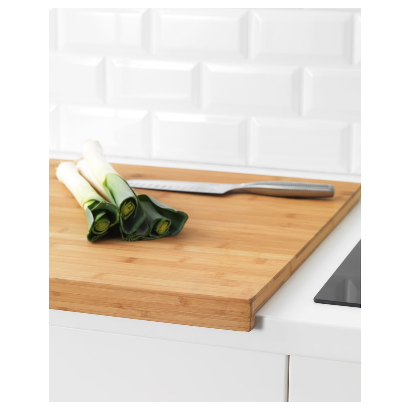 ... L?MPLIG chopping board The weight provides a stable base for cutting