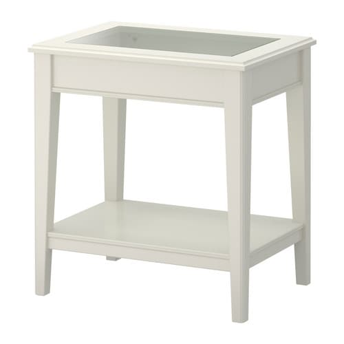 LIATORP Side table IKEA Separate shelf for storing magazines, etc.  ; keeps your things organised and the table top clear.