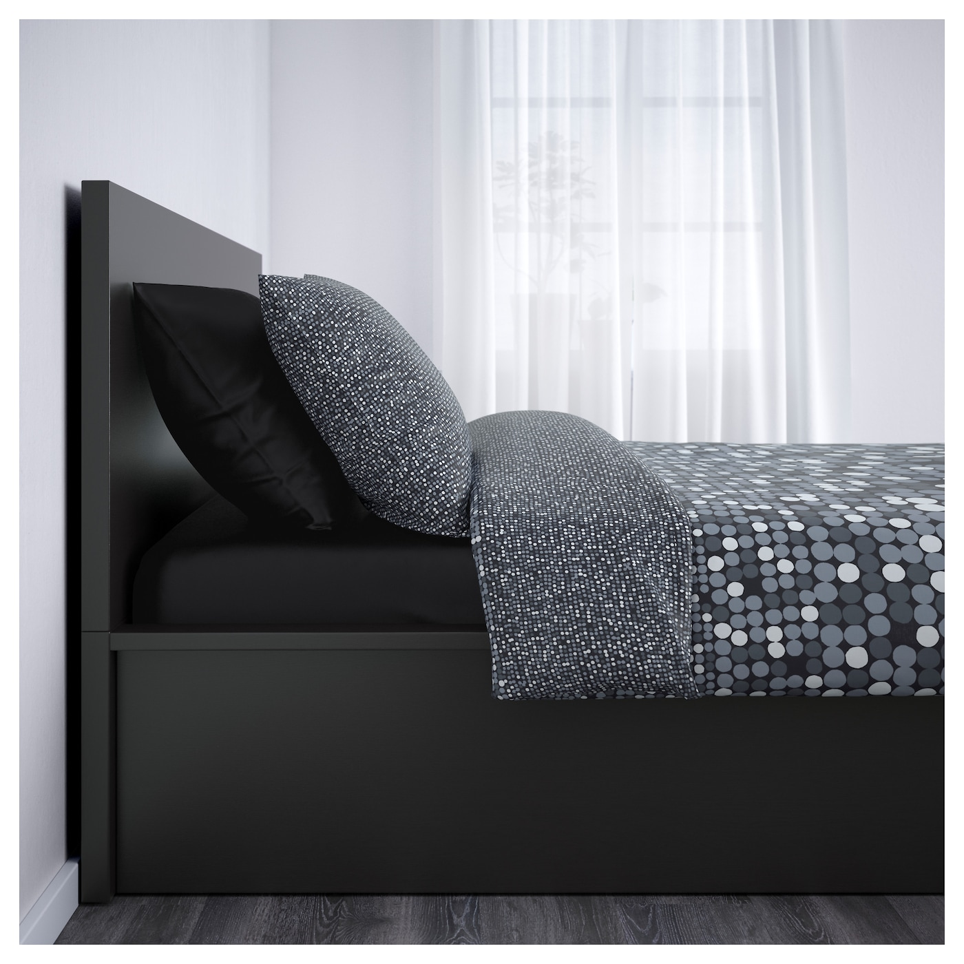 IKEA MALM ottoman bed Under the slatted base, which can be lifted, hides a practical storage space.