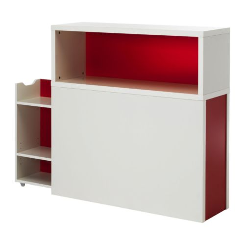 ODDA Headboard with storage compartment IKEA Headboard with open shelves and a hidden pull-out storage unit with castors.