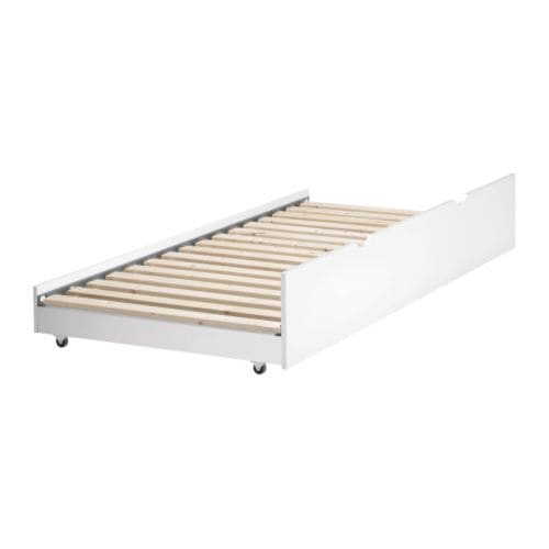 ODDA Underbed IKEA Adapted to get in under ODDA bed frame with headboard.  Cut-handles and castors; easy to pull out and push in.