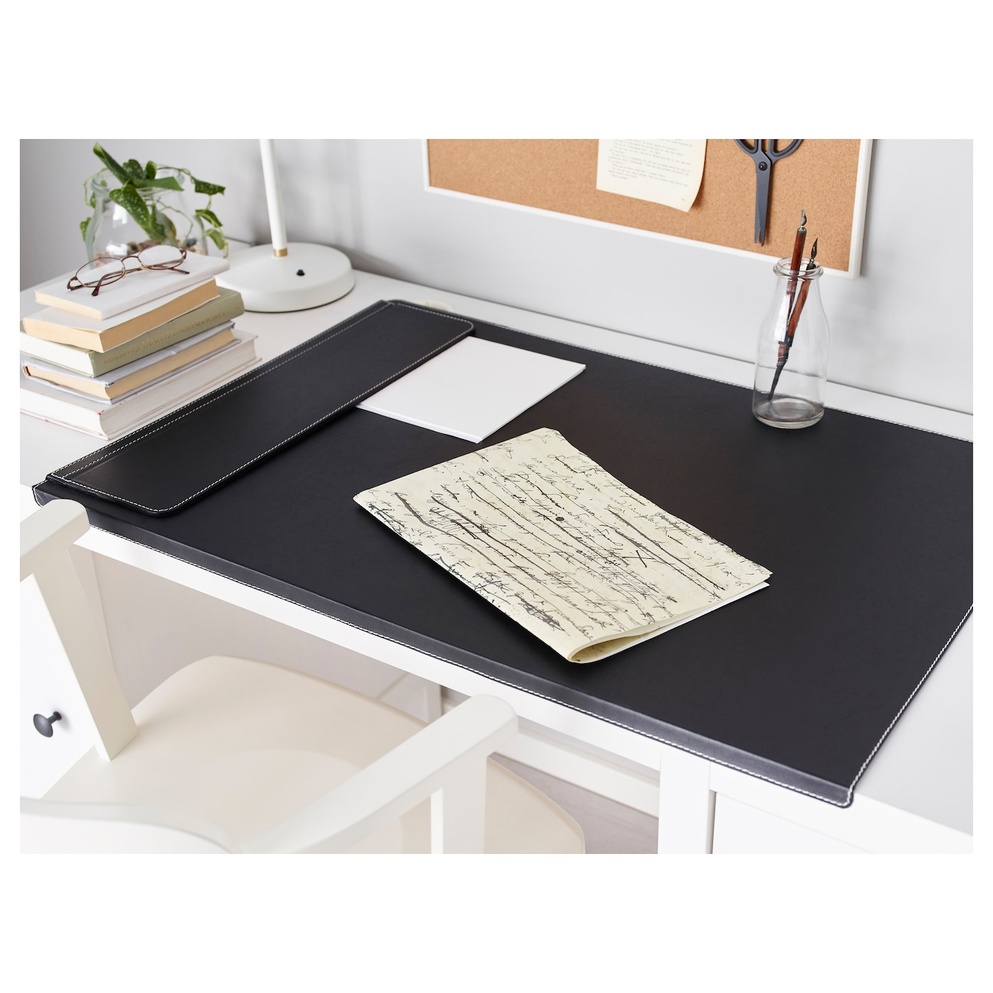 IKEA RISSLA desk pad The bent front edge keeps the desk pad in place.