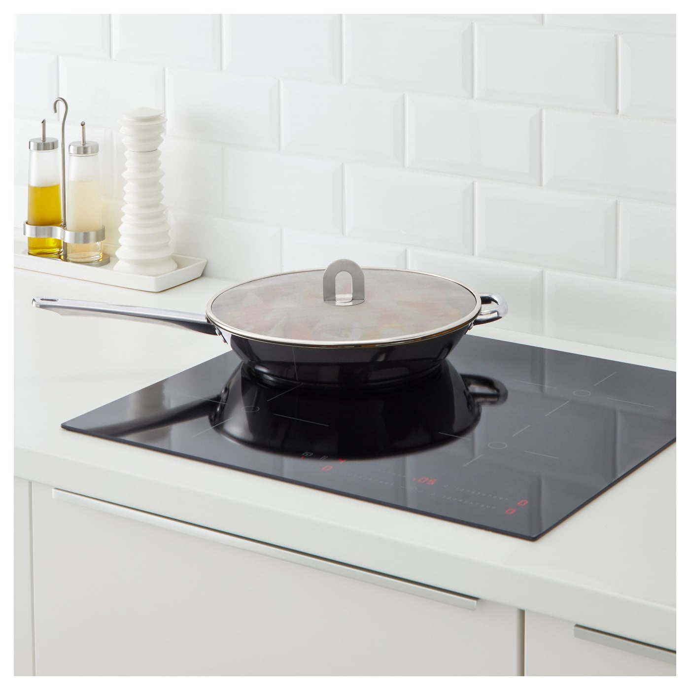IKEA STABIL splatter screen Holds most frying pans up to 32 cm in diameter.