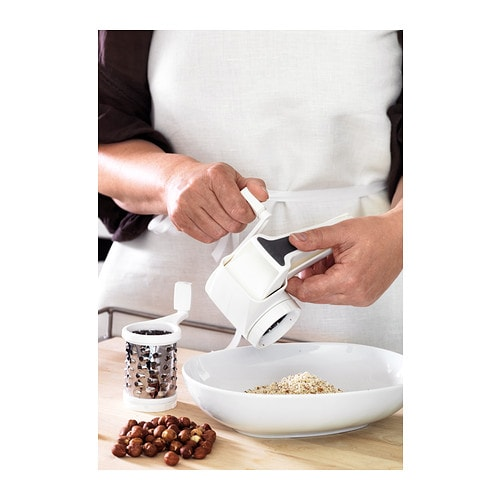 IKEA STRÅLANDE rotary grater Grates the food coarsely or finely depending on which insert you use.