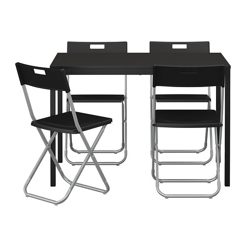 IKEA TÄRENDÖ/GUNDE table and 4 chairs Locks in the open position to prevent unintended folding.