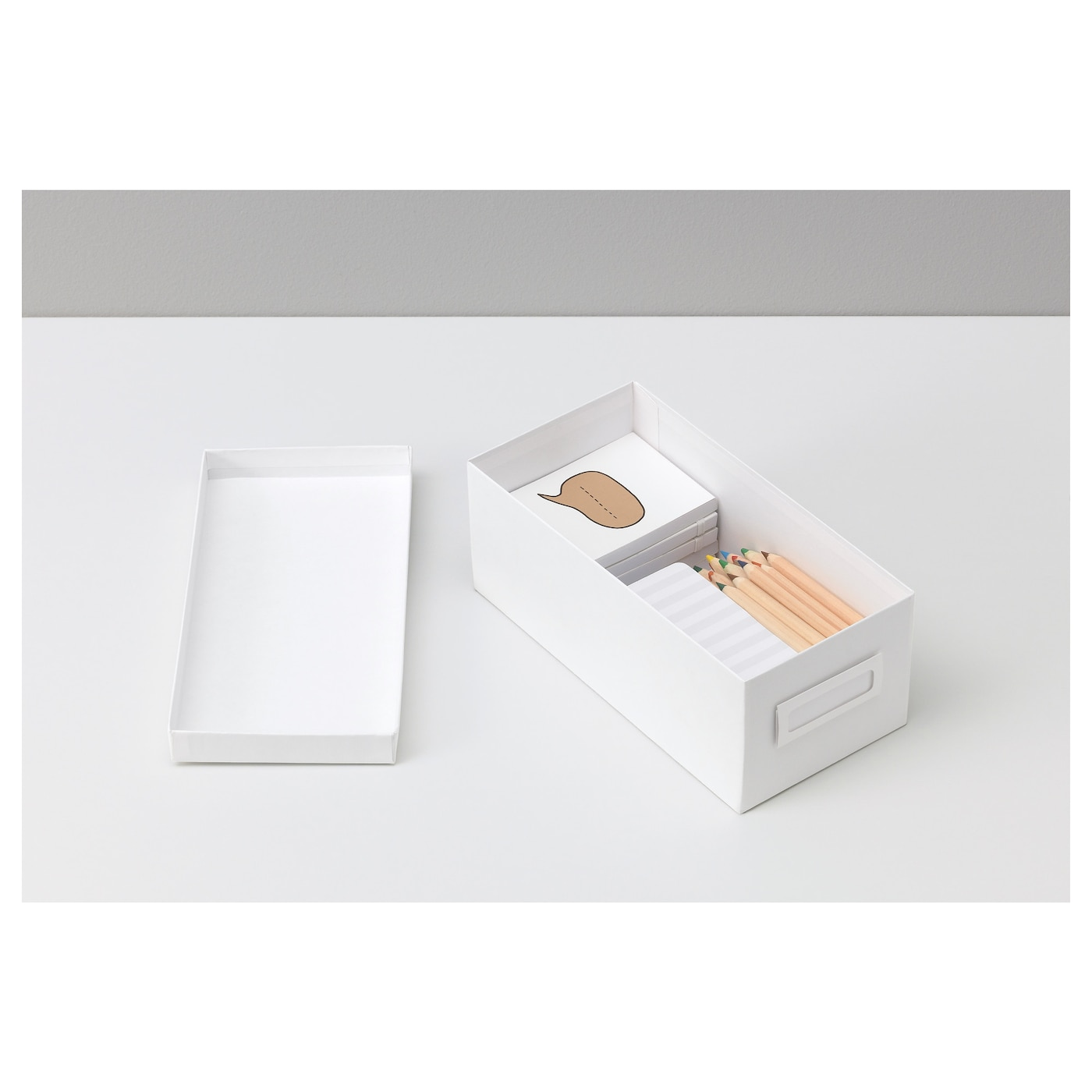 IKEA TJENA box with lid Suitable for storing small things like desk accessories and rechargers.