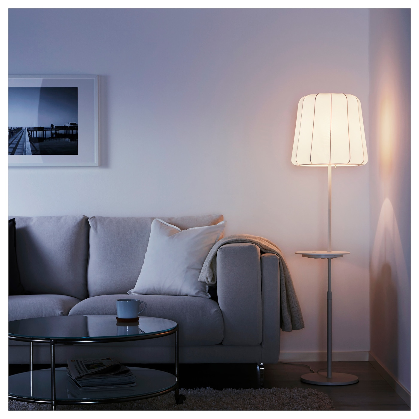 IKEA VARV floor lamp with wireless charging The height is adjustable to suit your lighting needs.