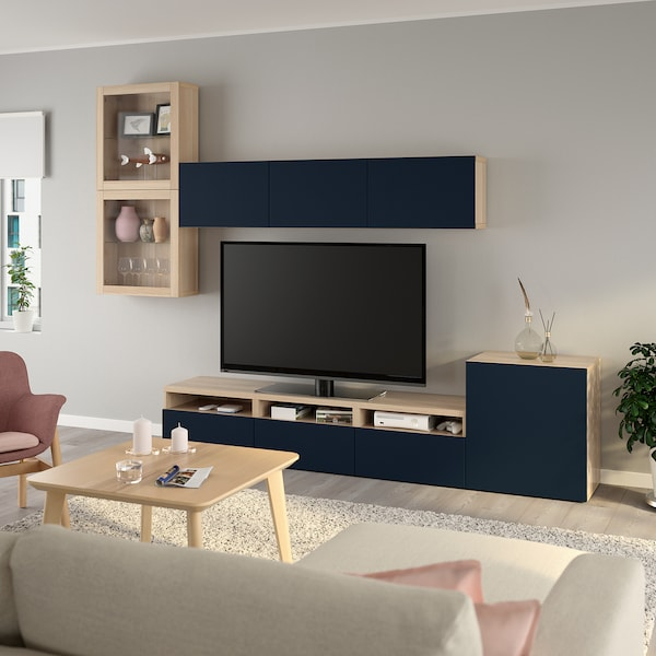 BESTÅ TV storage combination/glass doors, white stained oak effect/Notviken blue clear glass, 300x42x211 cm