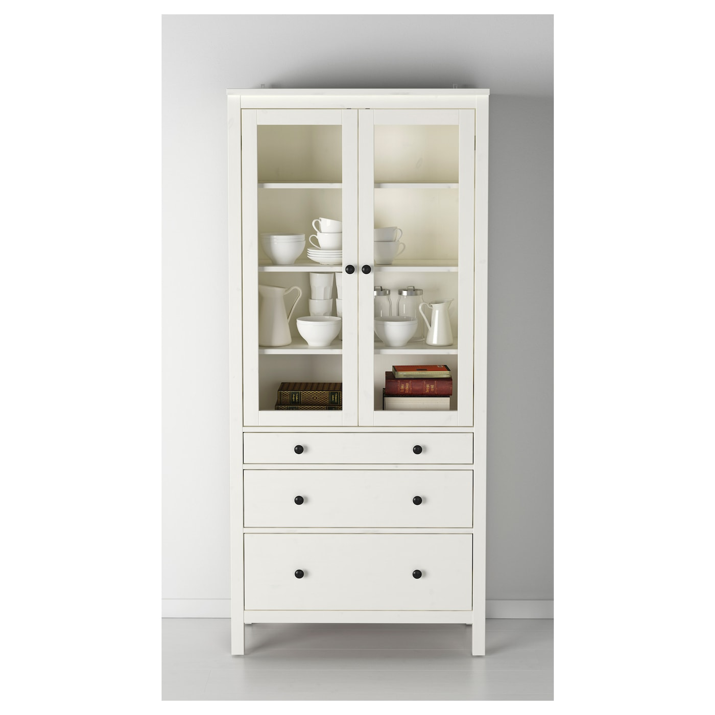 Hemnes glass door cabinet with 3 drawers white stain for Are ikea kitchen cabinets made of solid wood