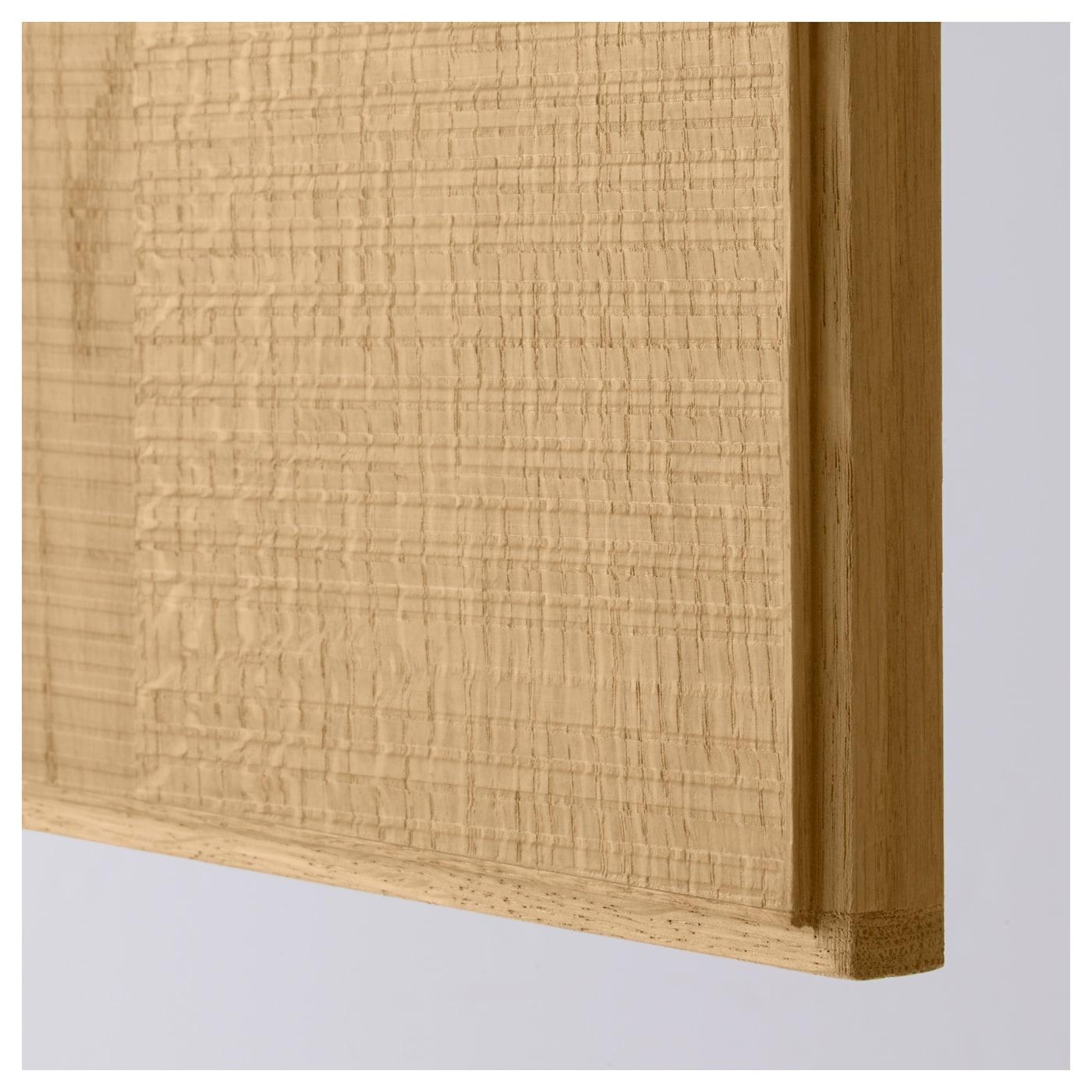 hyttan door has a solid oak frame and rough cut oak veneer panel with