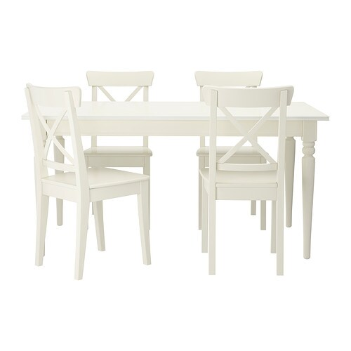 IKEA INGATORP/INGOLF table and 4 chairs The clear-lacquered surface is easy to wipe clean.