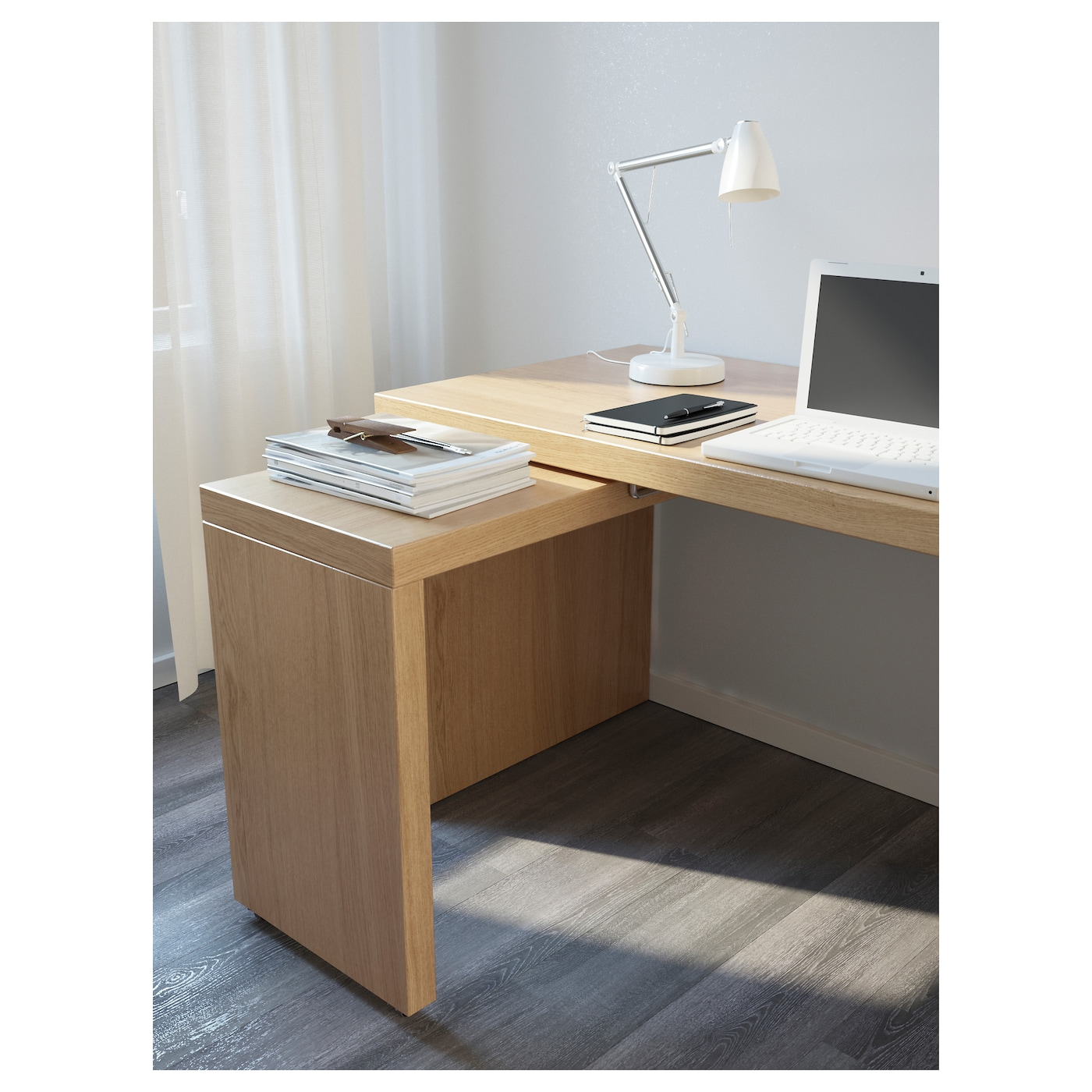 IKEA MALM desk with pull-out panel The pull-out panel gives you an extra work surface.