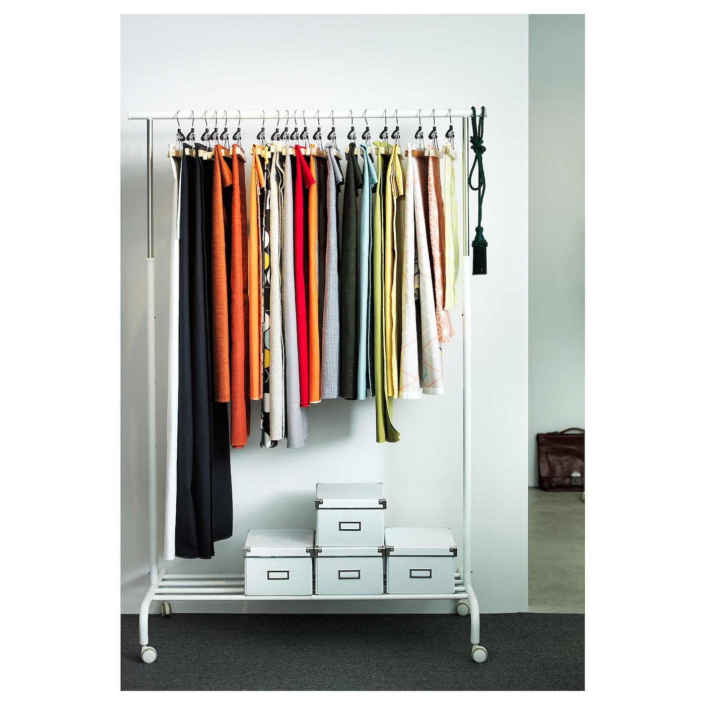 Ikea rigga clothes rack there is room for boxes or 4 pairs of shoes on the