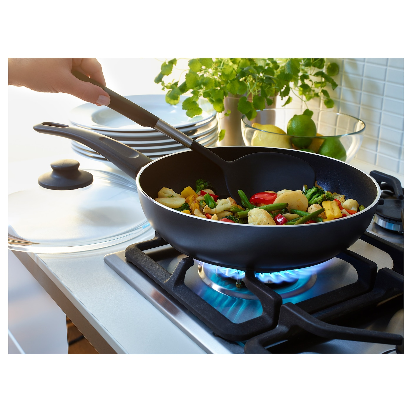 IKEA SKÄNKA sauté pan with lid Easy grip handle makes the pan easy to lift.
