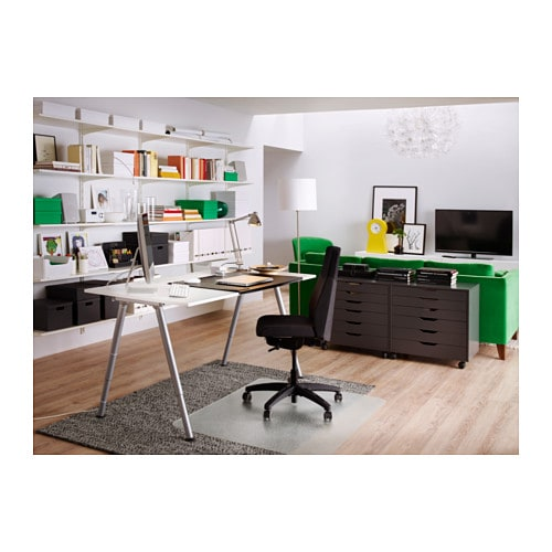 IKEA THYGE desk The melamine surface is durable, stain resistant and easy to keep clean.