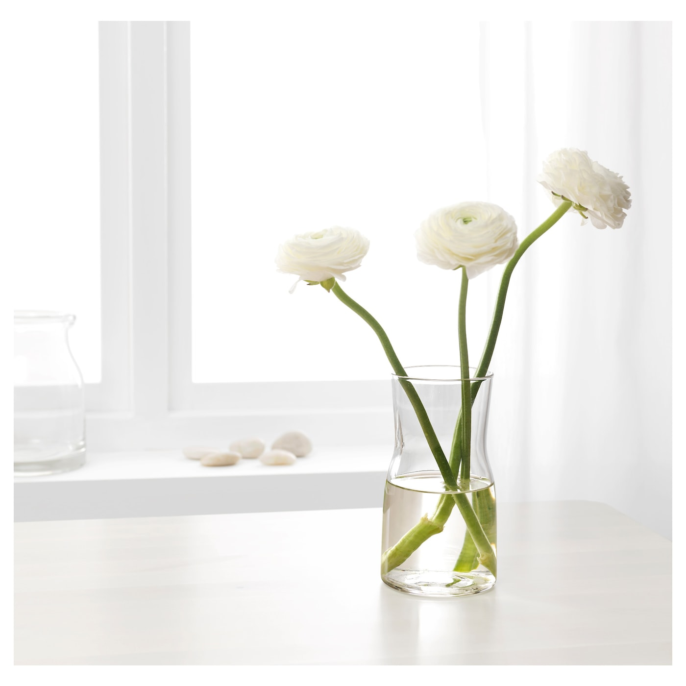 IKEA TIDVATTEN vase The vase is perfect for tulips and other short-stemmed flowers.