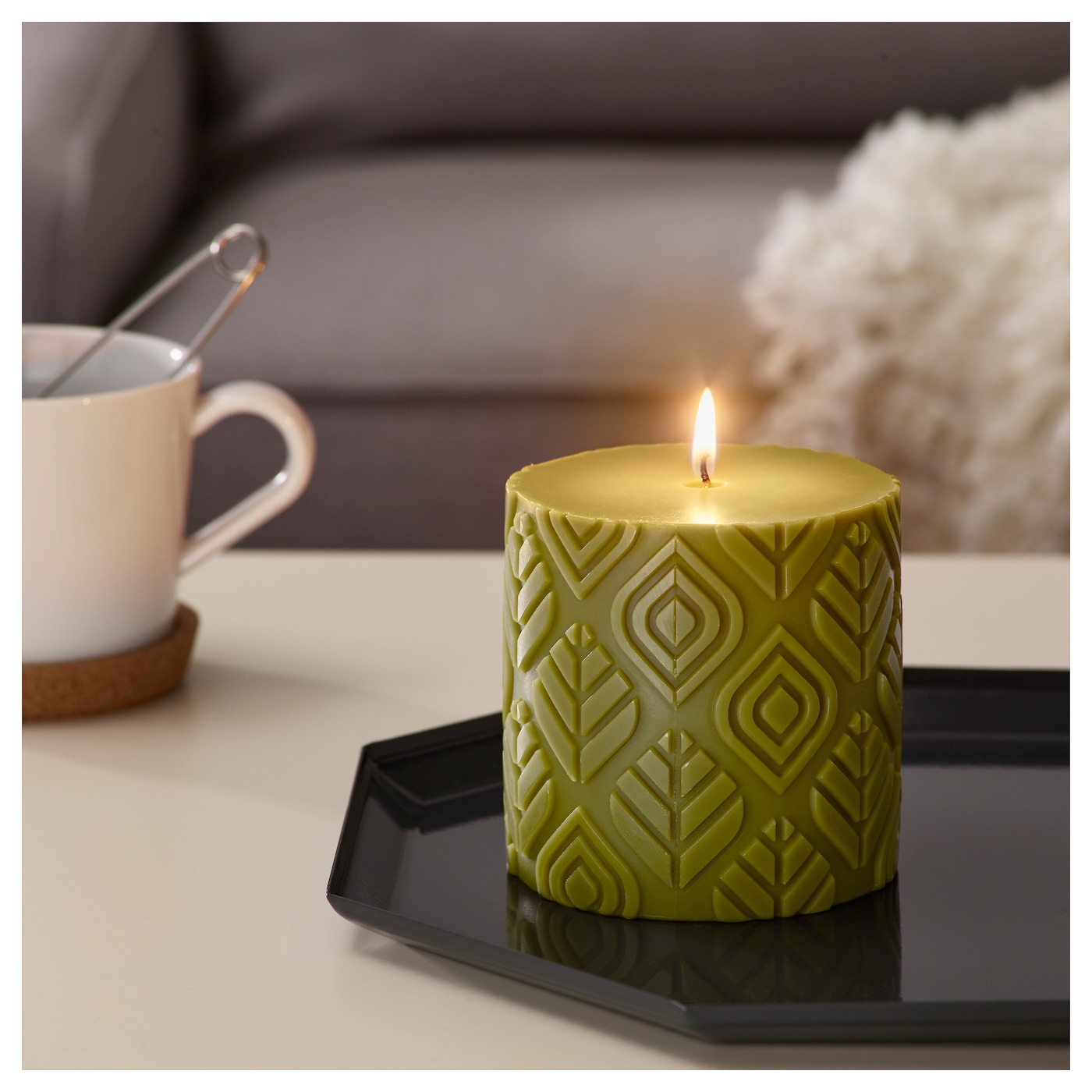 IKEA UTREDD scented block candle An earthy scent with notes of moss and forest.