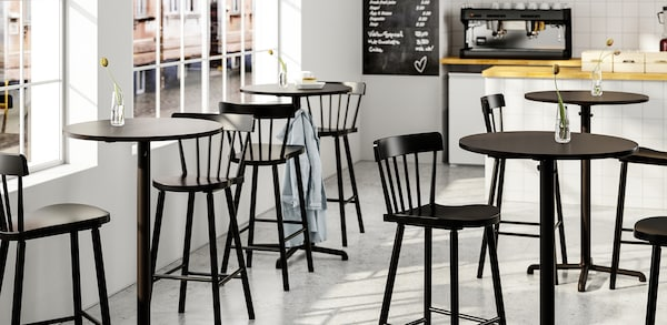 Cafe setting with black table and chair sets.
