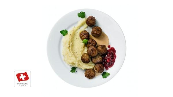 10 polpette di carne con puré, salsa a base di panna e mirtilli rossi CHF 6.95
