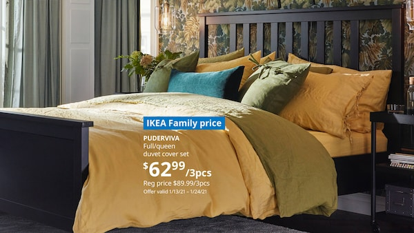 Bed against wall with floral wallpaper. IKEA Family price PUDERVIVA  Full/queen duvet cover set $62.99/3pcs reg $89.99/3pc