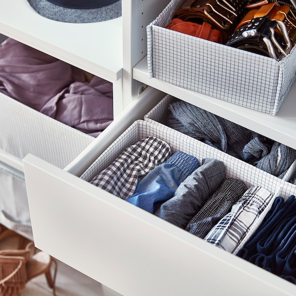 Close up of drawers filled with neatly folded underwear in STUK boxes with compartments.