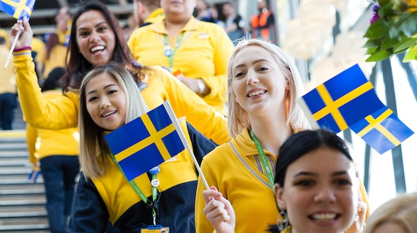 IKEA co-workers celebrating with Swedish flags