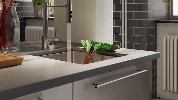 Custom quartz countertops in a clean, modern kitchen