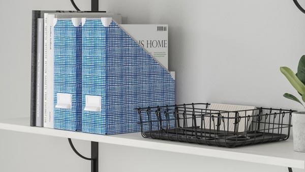 Blue FJALLA magazine holders and a black PLEJA tray