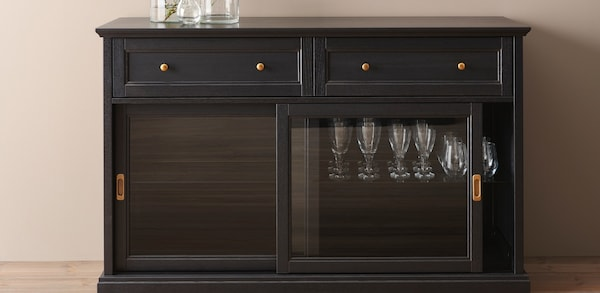 Black sideboard with glass stemware inside