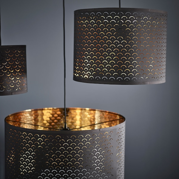 Three NYMÖ Lamp shades with a dark grey exterior and a shiny brass interior hanging