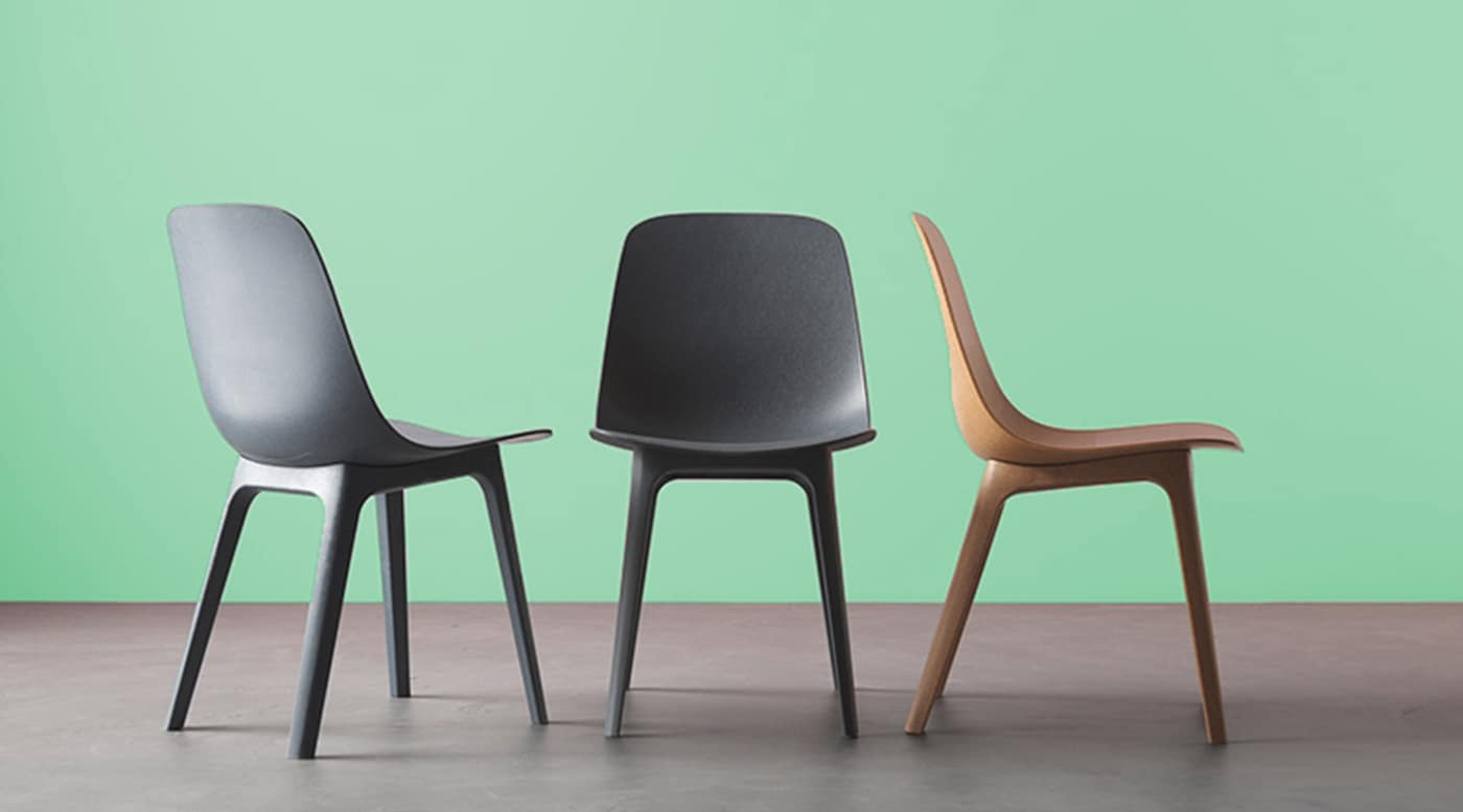 3 chairs sitting in a green room