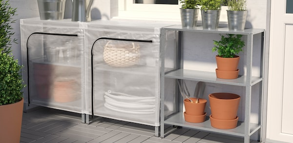 Outdoor shelving containing plant holders and gardening tools and outdoor shelves with covers on them.