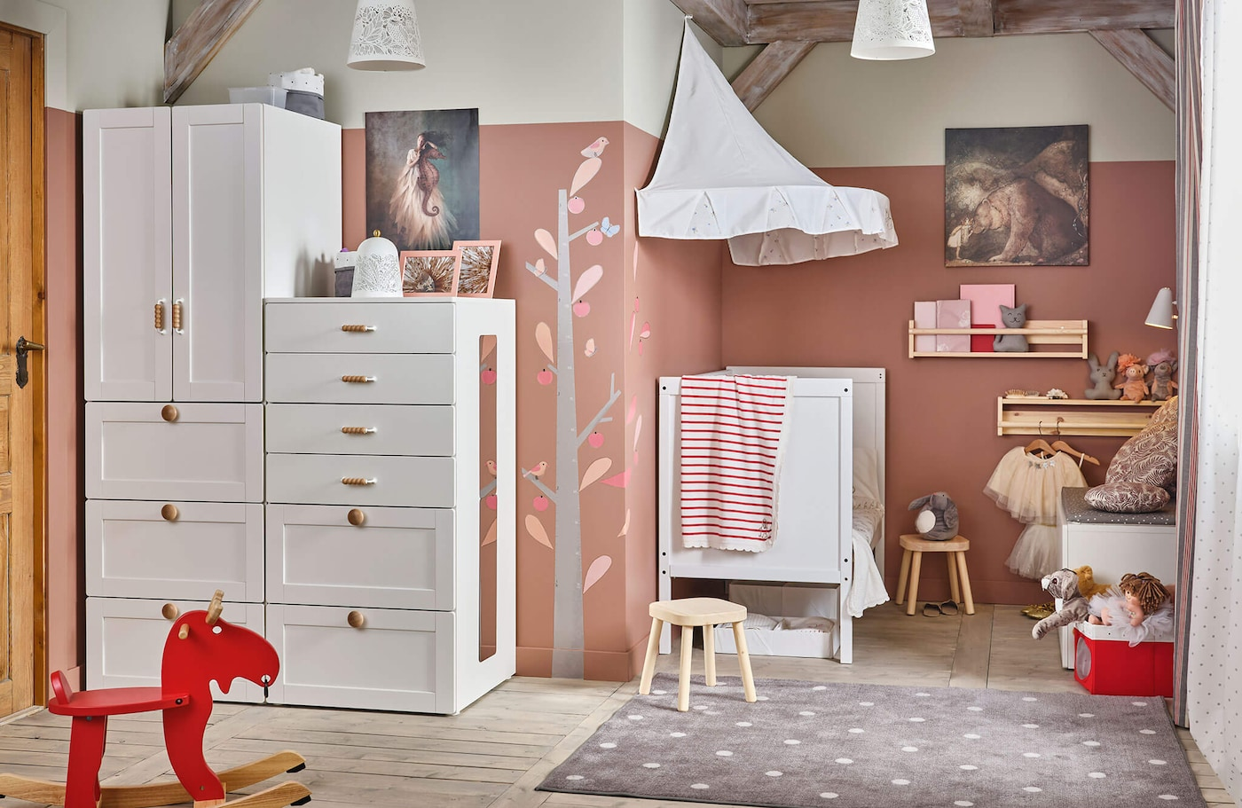 A white SMÅSTAD storage unit in a room with a white child's bed and other furniture, with a red rocking moose.