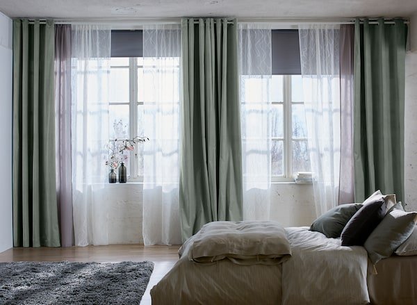 Layered SANELA and LILL curtains in a bedroom