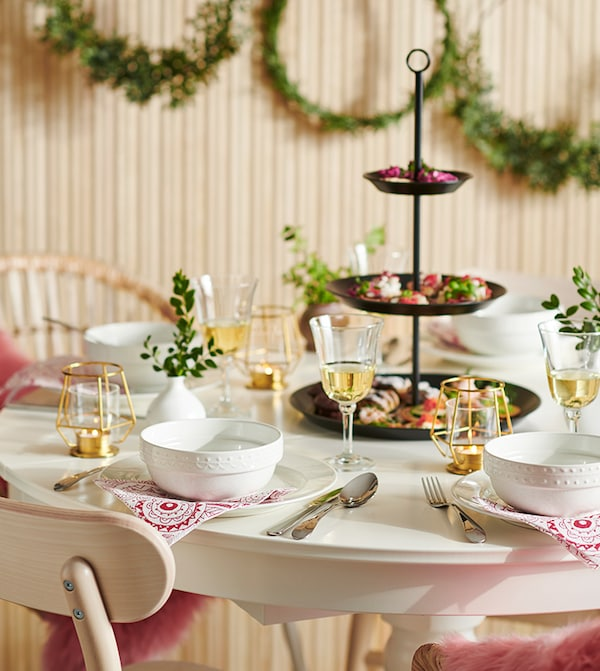 A festive table with white dinnerware.