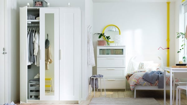 White three door wardrobe with a matching dresser