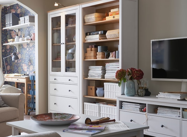 White HEMNES glass door cabinets, bookcases and media stand that links to the HEMNES living room series page