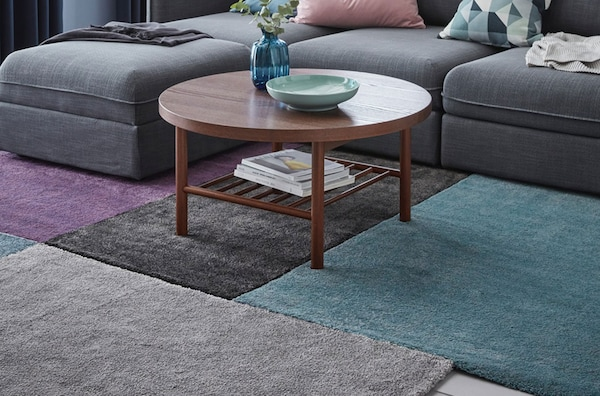 A close up of STOENSE rugs in various colours.