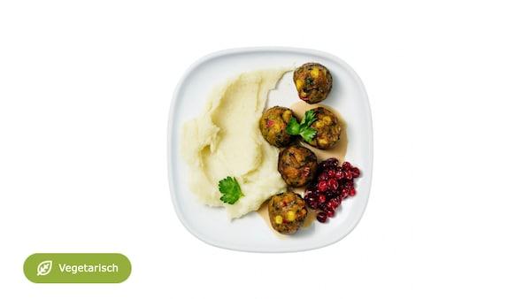 5 Gemüsebällchen mit Rahmsauce, Kartoffelstock, Saisongemüse inkl. Softdrink & Überraschung