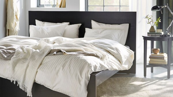 Black Brown Malm Bed In The Middle Of A Sunny Bedroom With White Bedding