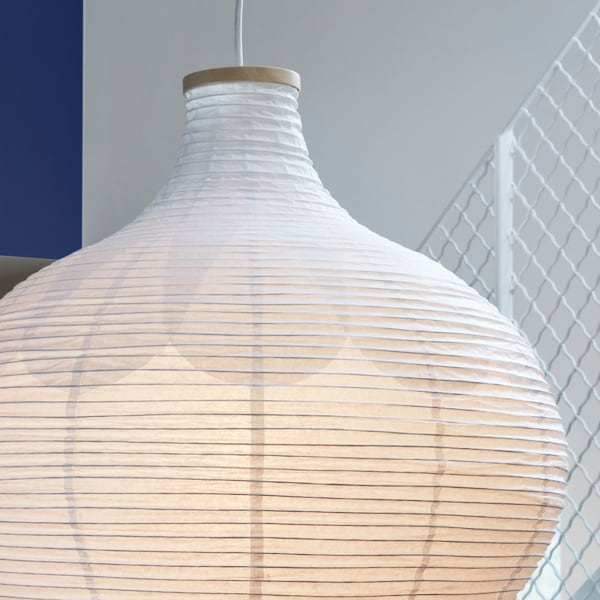 A close-up of RISBYN pendant lampshade made in an onion shape in thin rice paper with a discreet pattern in the paper.
