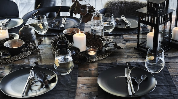 Table setting with black dinnerware and fall decorations