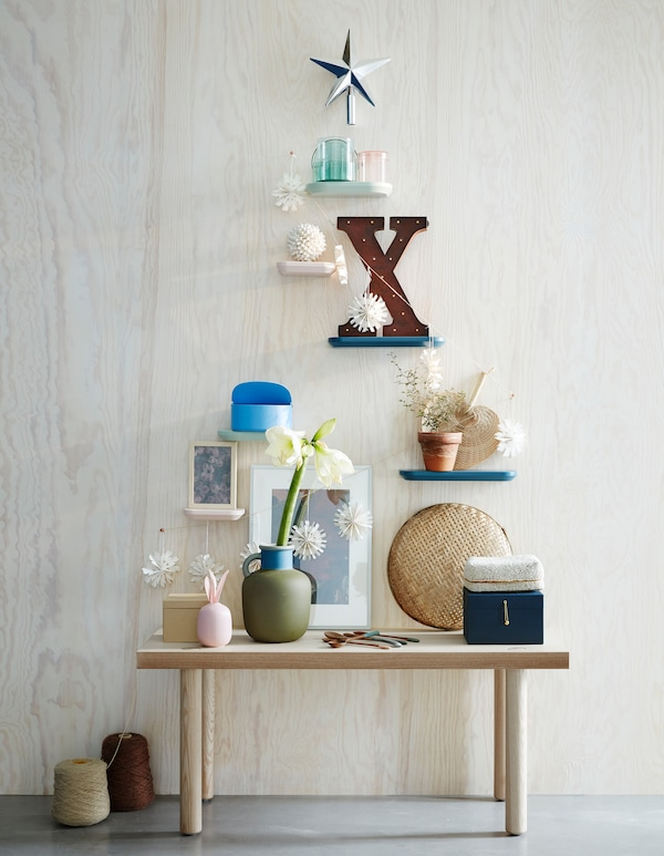 Want new living room decoration ideas this holiday? Go for an artificial Christmas tree as wall décor! Pimp your wall with deco and a star. IKEA has a lot of holiday deco such as VINTER 2017 top star in a glittery silver colour.