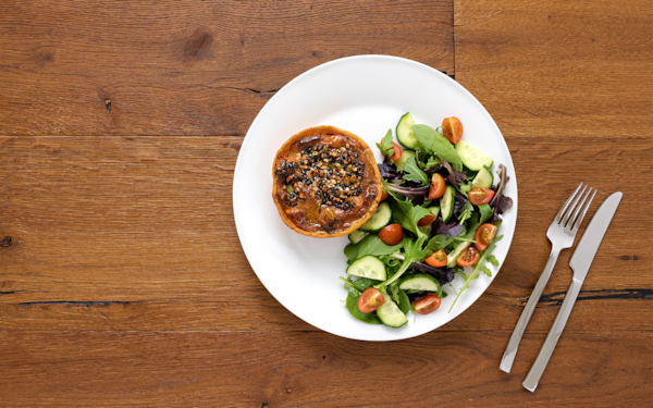 Sweet potato tart served with salad, with cutlery