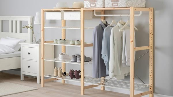 An IVAR wooden storage system with hanging and shelved clothes