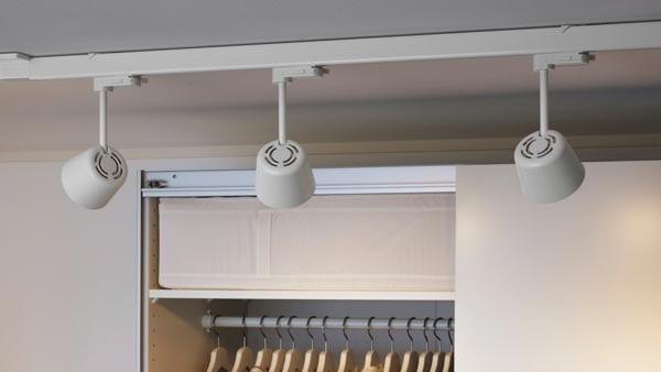 SKENINGE spotlights shining on a wardrobe