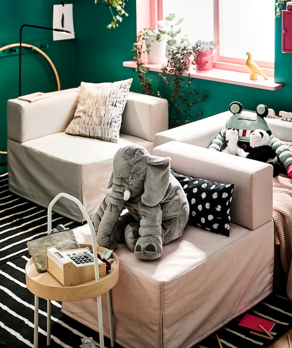 Modular seating in a living room with stuffed animals on the seats.