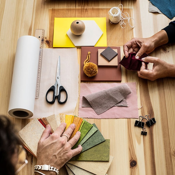 Zoomed in image of man and woman working with crafts